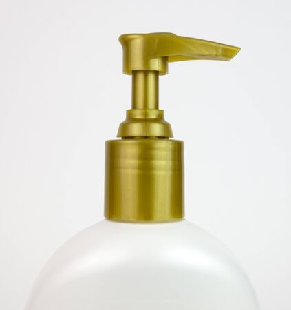Gold lotion bottle pump top. Stock Photo