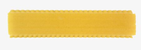 Isolated sheet of raw lasagne lasagna pasta with rippled edges.