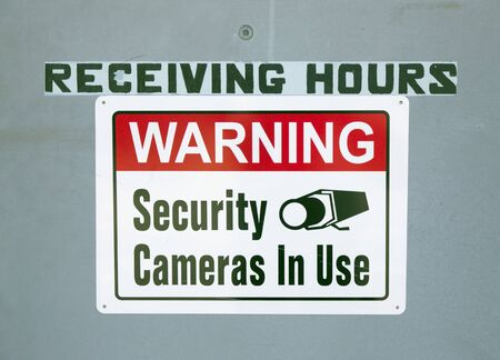 restricted area: WARNING SECURITY CAMERAS IN USE sign.