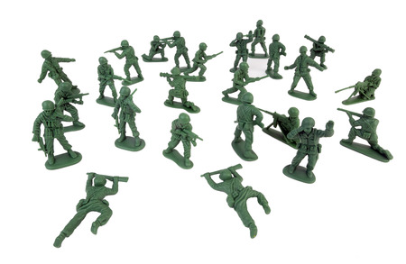 plastic soldier: Bunch of plastic toy green army men. Isolated.