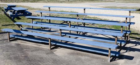 Smalltown USA blue wood baseball bleachers.