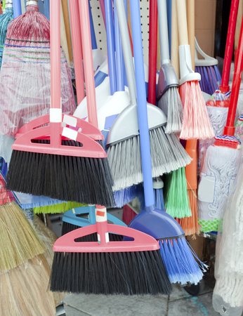 Colorful brooms for sale.