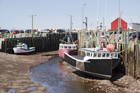 Halls Harbour is a fishing community in the Canadian province of Nova Scotia, located in Kings County on the North Mountain along the shore of the Bay of Fundy.