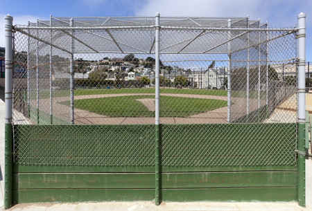 View of community park baseball field from behind backstop.