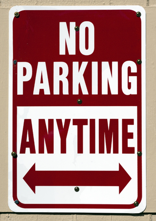 NO PARKING ANYTIME sign. Vertical.