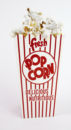 Red and white box of popcorn. Vertical.