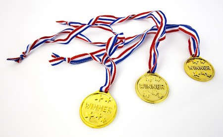 Three plastic gold WINNER medals with patriotic red, white and blue lanyards.