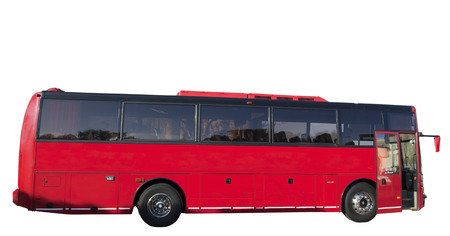 Isolated red tour charter sightseeing charter tour bus in urban location. Horizontal.