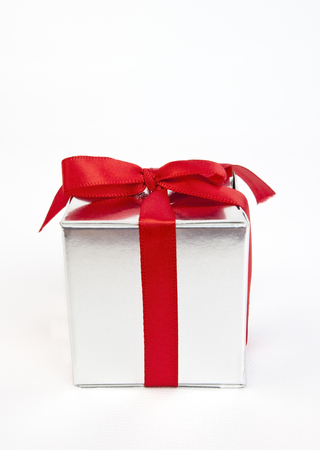 Simple silver gift box with red ribbon bow.
