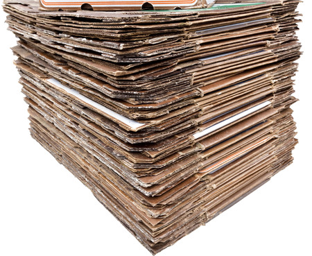 Isolated neatly stacked cardboard for recycling. Banco de Imagens