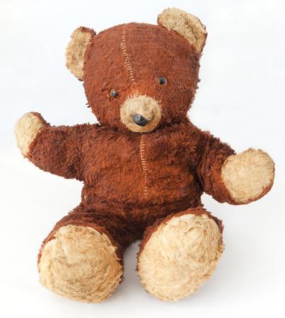 Old, worn, threadbare vintage 1940s teddy bear. Isolated.