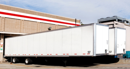 Freight trailers at warehouse loading dock. Stok Fotoğraf