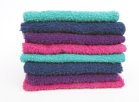 Front view of stacked washcloths. Isolated.