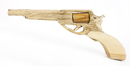 Handmade carved wood toy gun. Isolated.