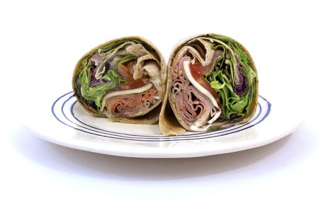 Isolated roast beef sandwich wrap on plate