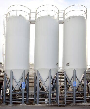 Three craft beer brewery tank silos.