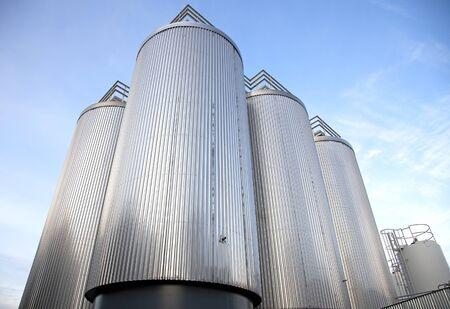 Grain elevator silos with sky background.