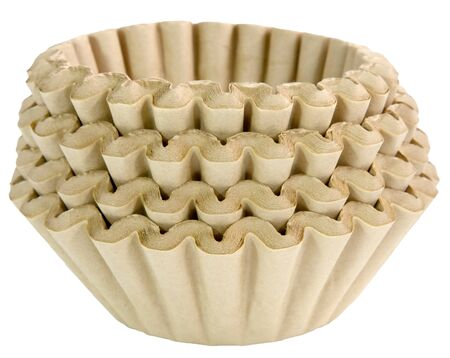 Stacked unbleached brown basket coffee filters. Isolated. Imagens