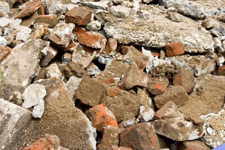 Pile of construction rubble: brick, cement, concrete and dirt.