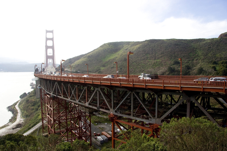 North approach to San Franciscos Golden Gate Bridge with fog rolling in.