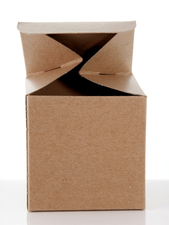 Small open cardboard gift box without wrapping on a reflective surface.