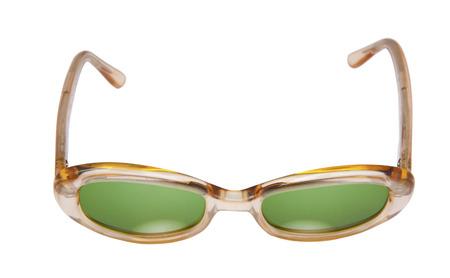 Vintage female tortoise shell sunglasses with green lenses. Isolated.
