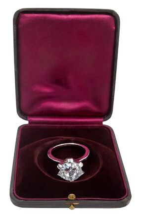 Costume diamond ring in old fashioned dark red velvet case.