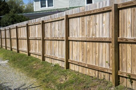 Newly constructed backyard fence facing alley.