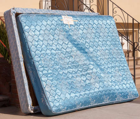 Relatively clean mattress and box spring discarded outside urban apartment building. Free to good home.