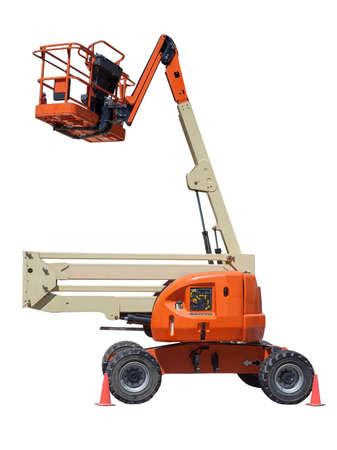 Isolated orange and cream colored hydraulic cherry picker.