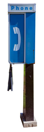 Vintage blue and white payphone booth with empty phonebook cover. Isolated.