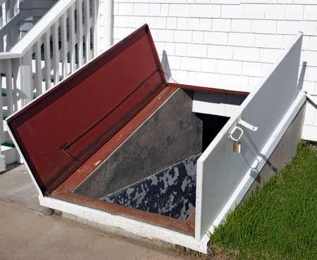 Open door to storm cellar. Reklamní fotografie
