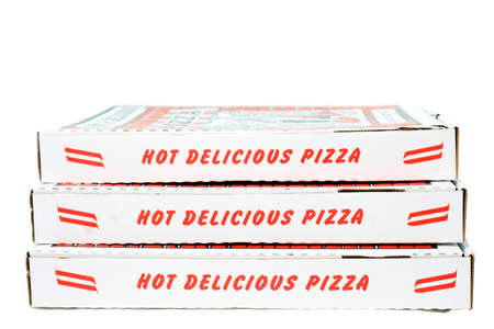 Stack of closed red text on white pizza boxes. Vertical.