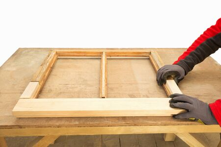 Restoration of a window frame. Close up of a carpenter repairing sash window frame. Sash window restoration.