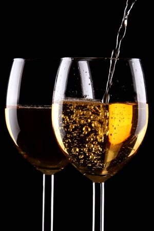 pinot grigio: White wine glasses on black