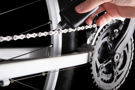 Bicicletas engrasar la cadena Foto de archivo