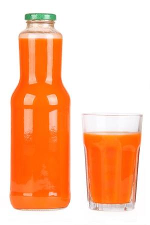 Botella de jugo de zanahoria Foto de archivo