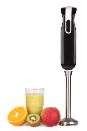 Blender y el jugo de fruta fresca Foto de archivo