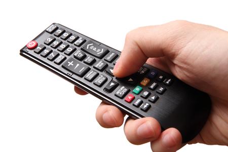 control remoto sosteniendo tv mano Foto de archivo