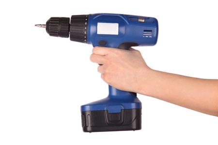 Mano que sostiene el destornillador inalámbrico Foto de archivo