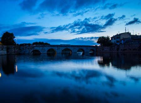 The Bridge of Tiberius in Rimini at sunset Stock Photo