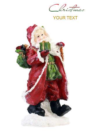 Santa Claus figurine isolated on white background photo