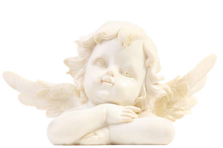 One little angel figurine with crossed arms on white background photo