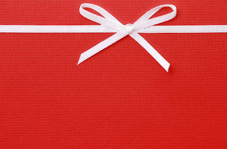 Blank red invitation card with bow photo