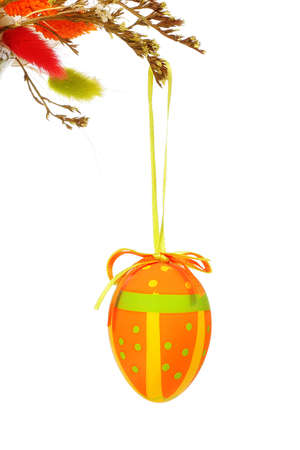 Easter egg hanging on a floral bouquet photo