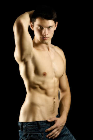 Sexy muscular man isolated on black background Stock Photo - 9448929