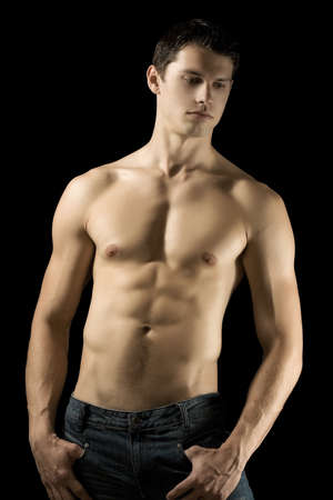 Sexy muscular man isolated on black background Stock Photo - 9616505