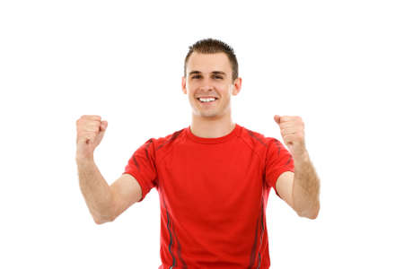 triumphant: Portrait of a very happy young man with his arms raised