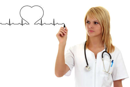heart doctor: Female doctor drawing a heartbeat Medical concept