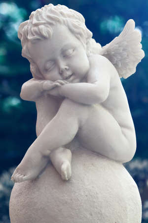 A sleeping angel statue photo